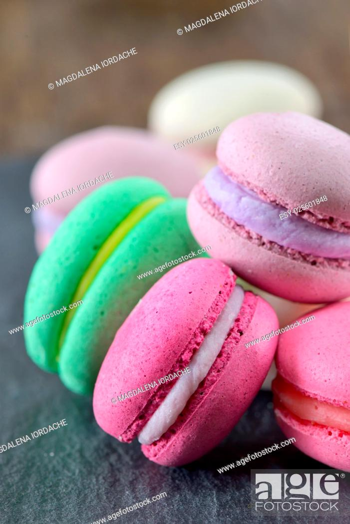 Stock Photo: Colorful macaroons on ardesia stone plate.