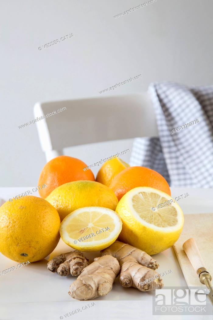 Stock Photo: Lemons, oranges and fresh ginger.