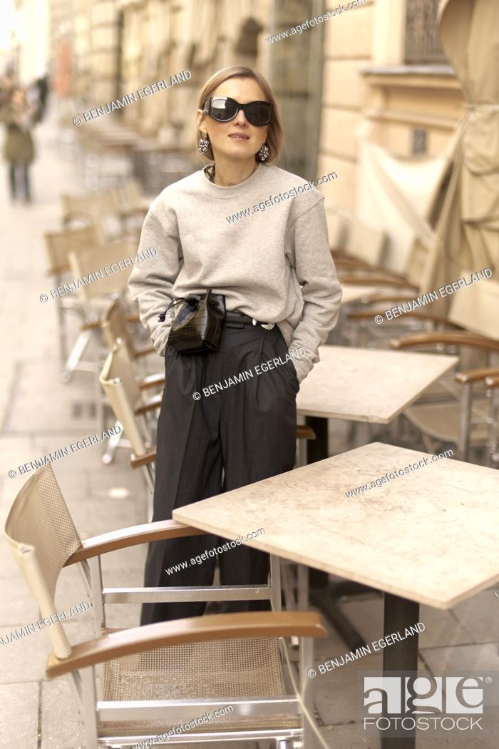 Stock Photo: stylish blogger woman at street, streetstyle, in Munich, Bavaria, Germany.