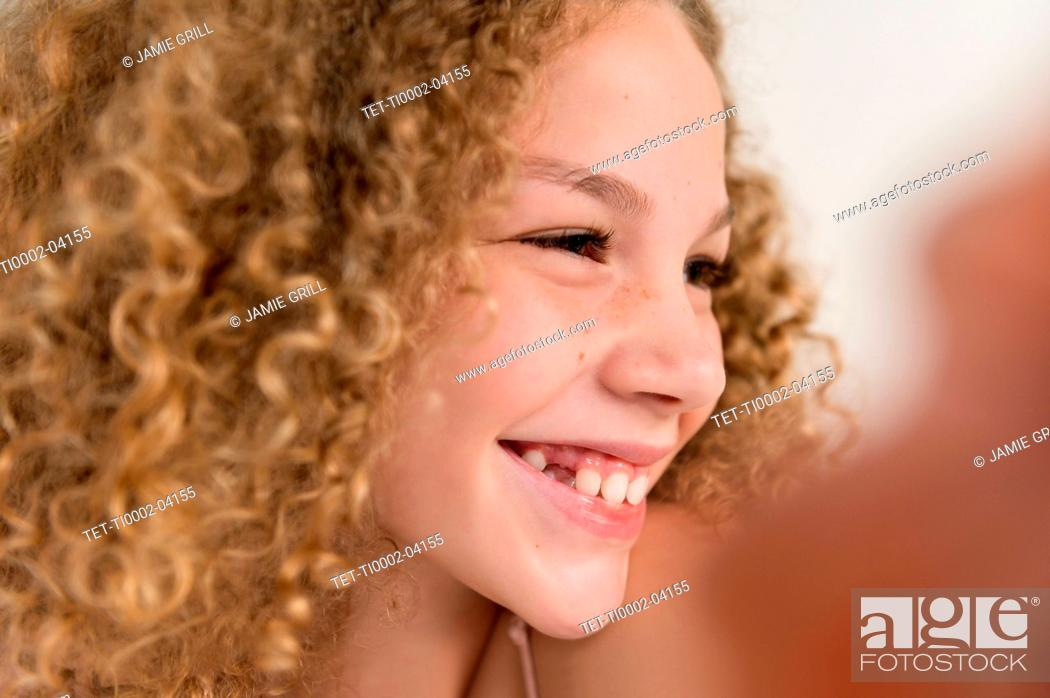 Stock Photo: Portrait of girl smiling.