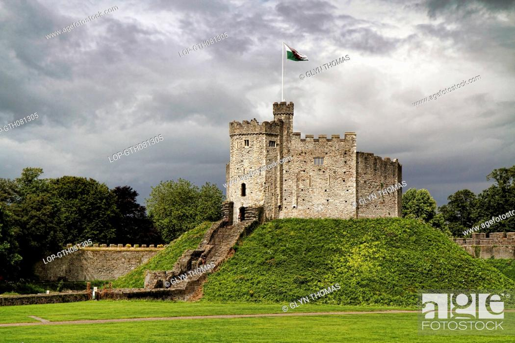 Stock Photo: Wales, South Glamorgan, Cardiff. Storm clouds over Cardiff Castle keep.