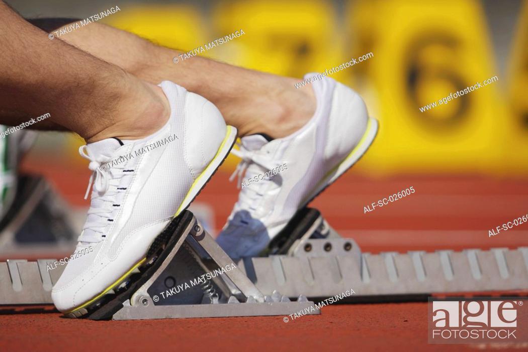 Photo de stock: Runner at Starting Line.