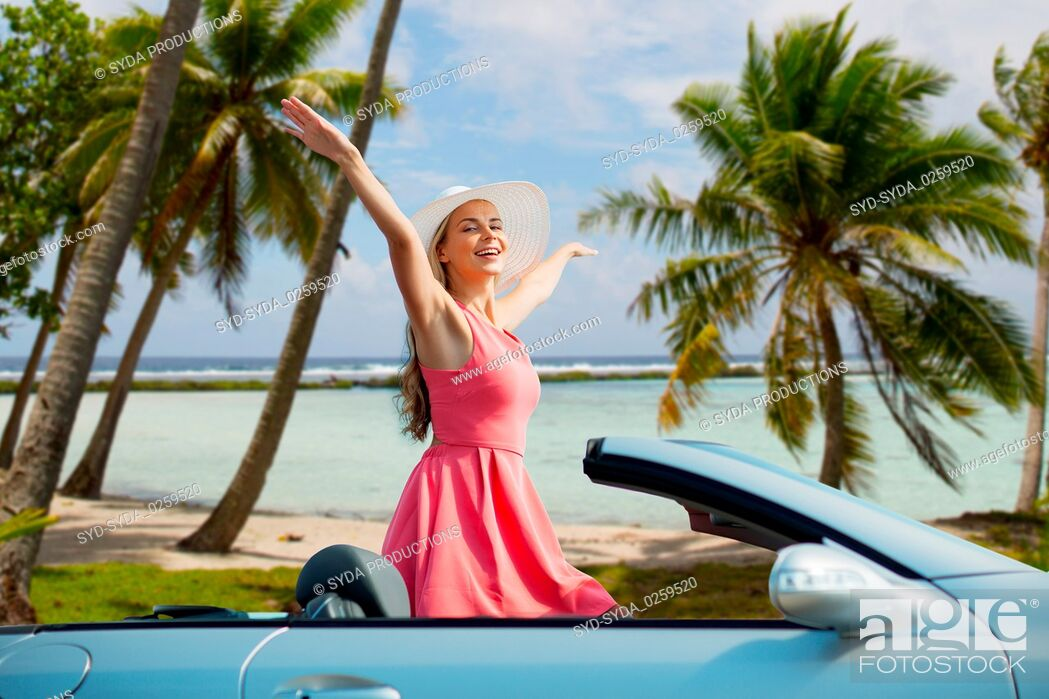 Stock Photo: happy young woman in convertible car over beach.
