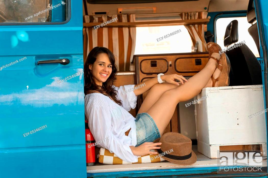 Stock Photo: summer holidays, road trip, vacation, travel and people concept - smiling young hippie women in car.