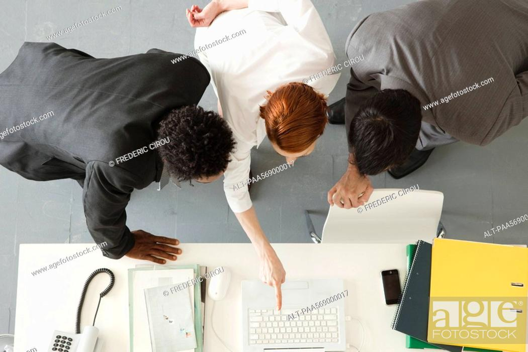Stock Photo: Business associates collaborating on project.