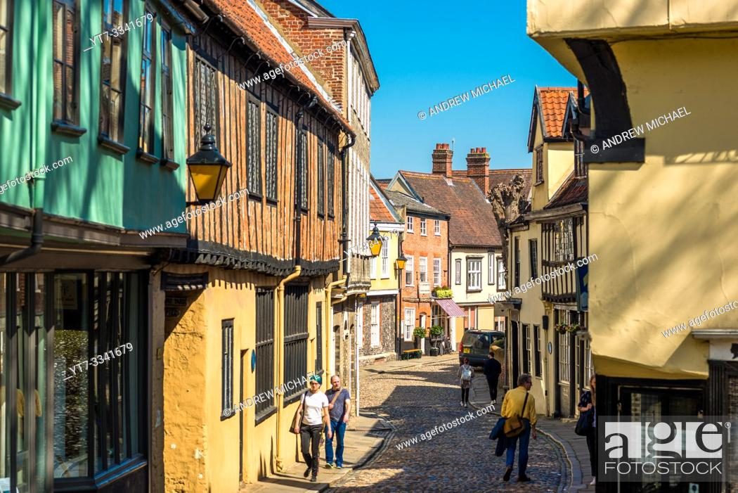 Stock Photo: Cobbled street and shops of the medieval street of Elm Hill in Norwich city centre, Norfolk, East Anglia, England, UK.