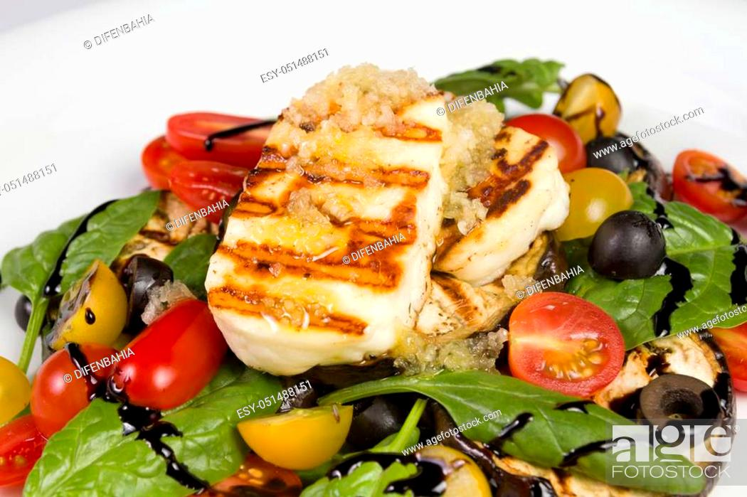 Stock Photo: Grilled Halloumi Cheese poured with garlic olive oil salad witch grilled eggplant, cherry tomatoes, black olives and spinach. healthy food. Close up.