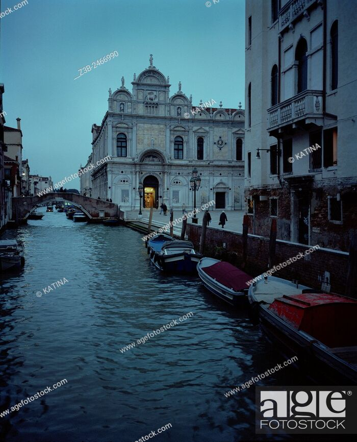 Stock Photo: Venetian canal at dusk and the Scuola Grande di San Marco Hospital in the Castello district of Venice, Italy, Europe.