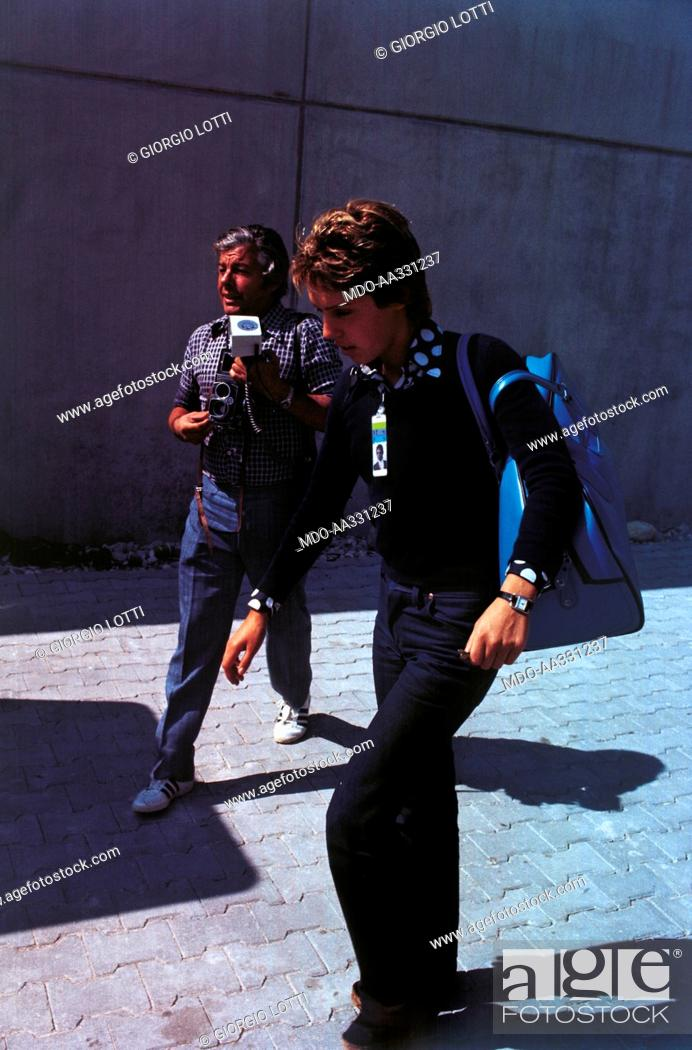 Novella calligaris and a phographer next to her the young swimming stock photo novella calligaris and a phographer next to her the young swimming champion novella calligaris during the olympic games giving her much thecheapjerseys Choice Image
