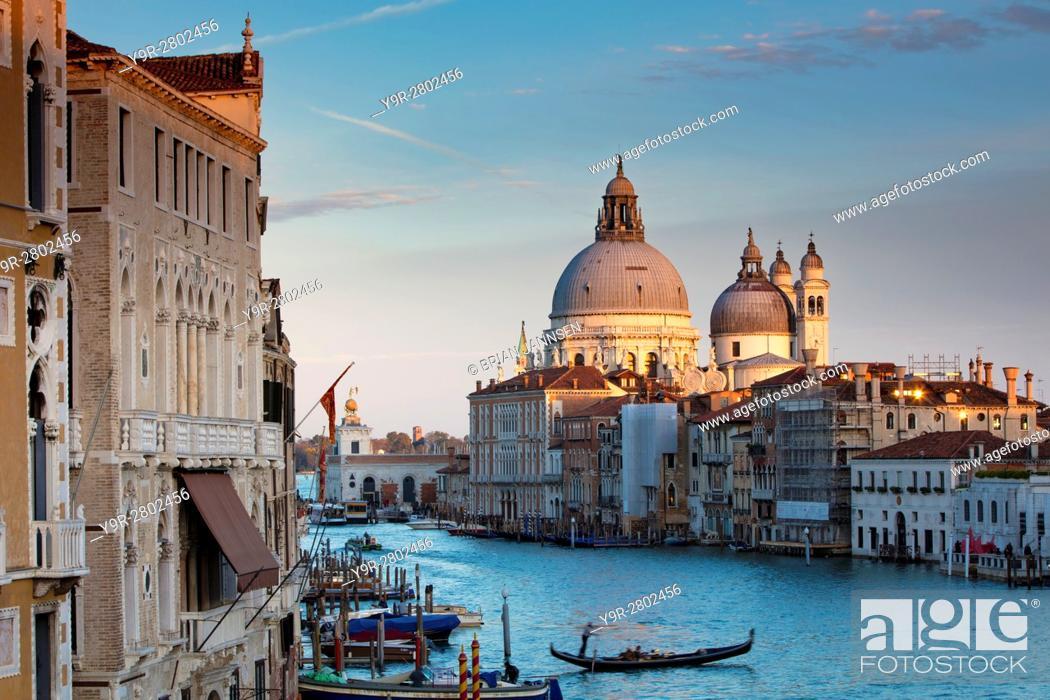 Stock Photo: Last light on the domes of Santa Maria della Salute along the Grand Canal, Venice, Veneto, Italy.