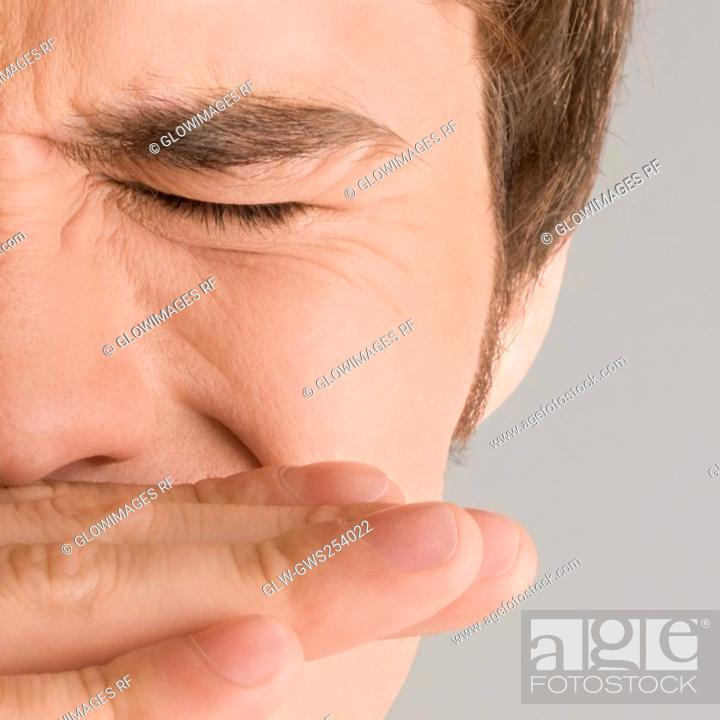 Stock Photo: Close-up of a young man with his eyes closed.