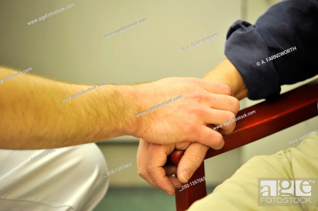 Stock Photo: Doctor feeling the pulse of an elderly patient, Stockholm, Sweden.
