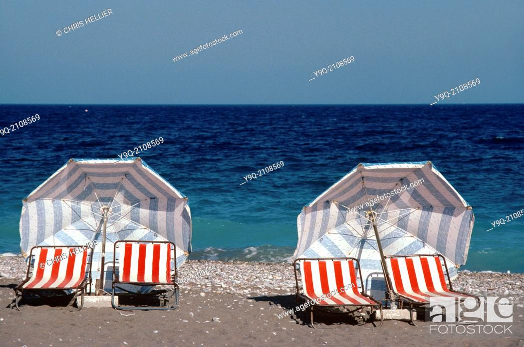 Imagen: Deckchairs & Umbrellas or Parasols on Deserted Beach Rhodes Greece.