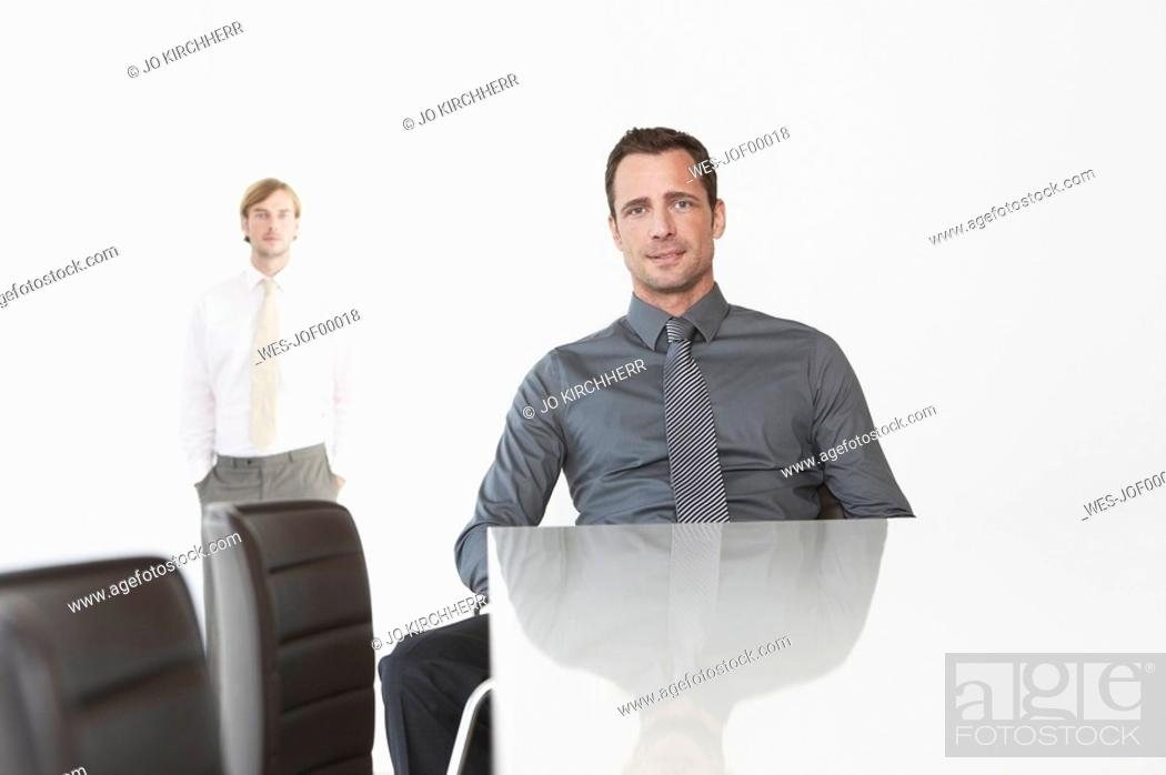 Stock Photo: Germany, Cologne, Two businessmen in conference room.