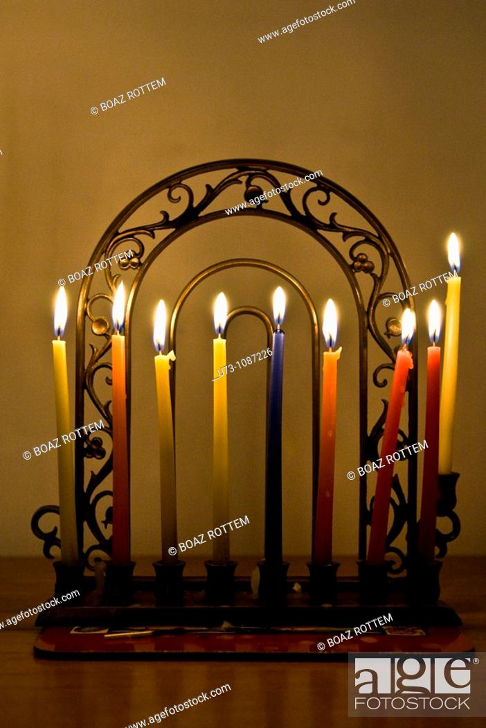 Stock Photo: Hannukkia with 8 candles burning during the Jewish festival of Hanukkah.