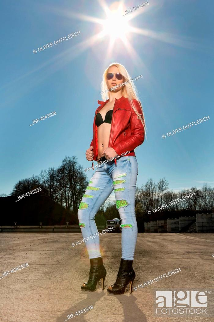 Stock Photo: Young woman blonde, poses cool with sunglasses and red leather jacket, fashion, lifestyle.