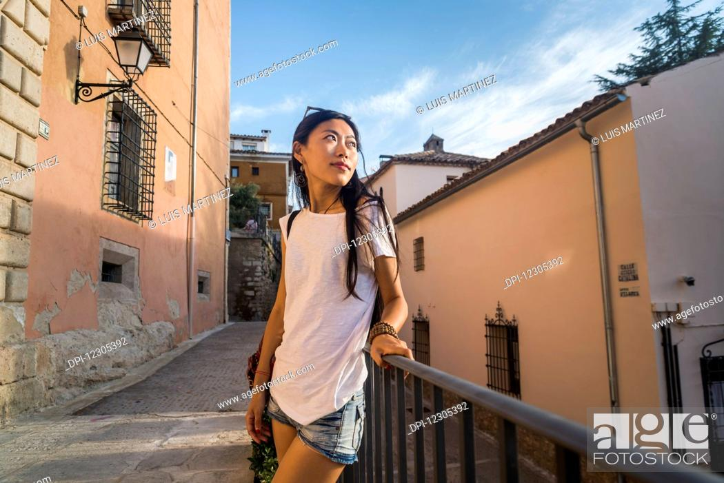 Stock Photo: A young Chinese woman in downtown Cuenca; Cuenca, Castile-La Mancha, Spain.
