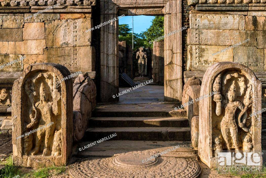 Stock Photo: The entrance to the Hatadage with Sandakada pahana, also known as Moon-stone and Nagaraja Guardstone. Ruins of the Hatadage built by King Nissanka Malla.