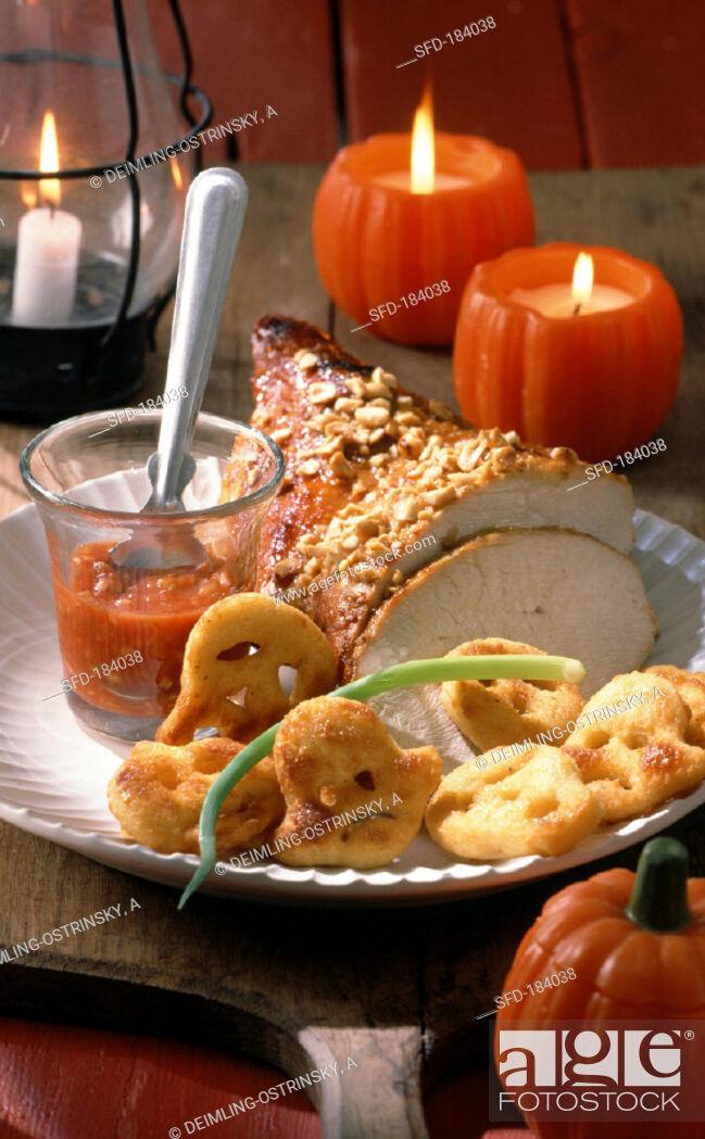 Stock Photo: Roast turkey with devilish sauce and ghost potatoes.