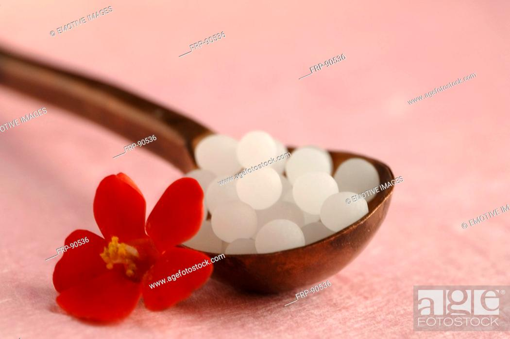 Stock Photo: Globules and red flower.