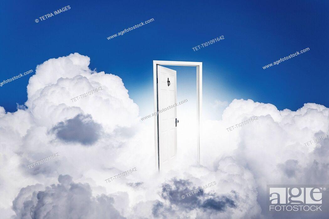 Stock Photo: Opened door in clouds.