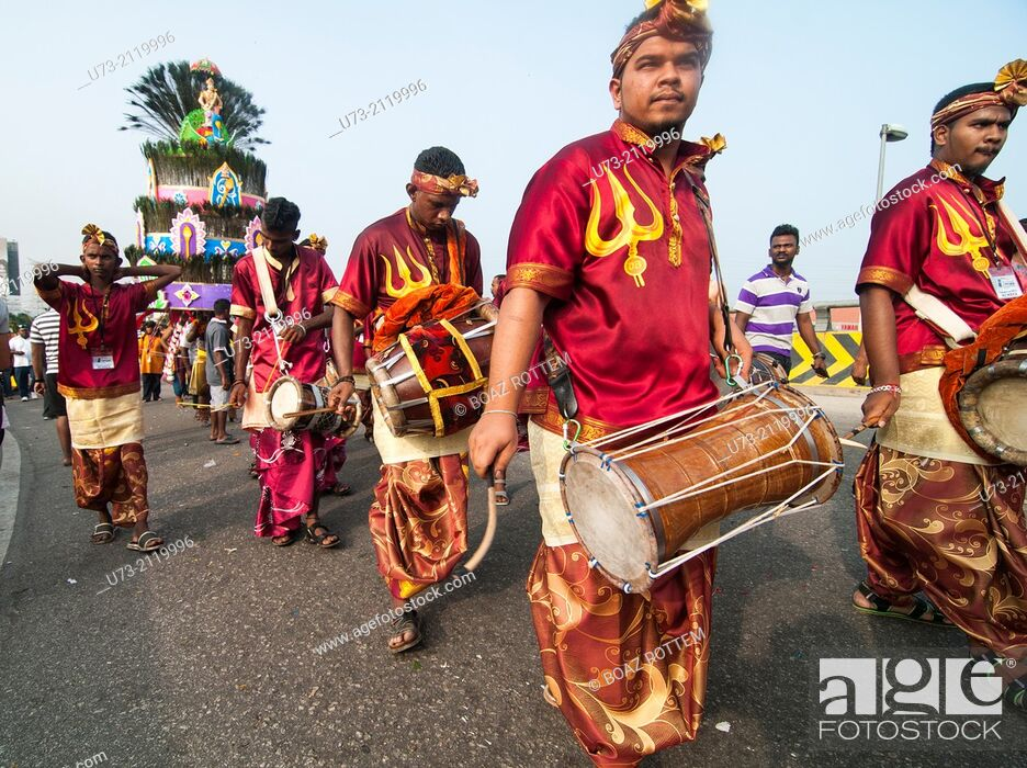 Stock Photo: Drummers & percussion players leading a procession during the Thaipusam festival in KL, Malaysia.