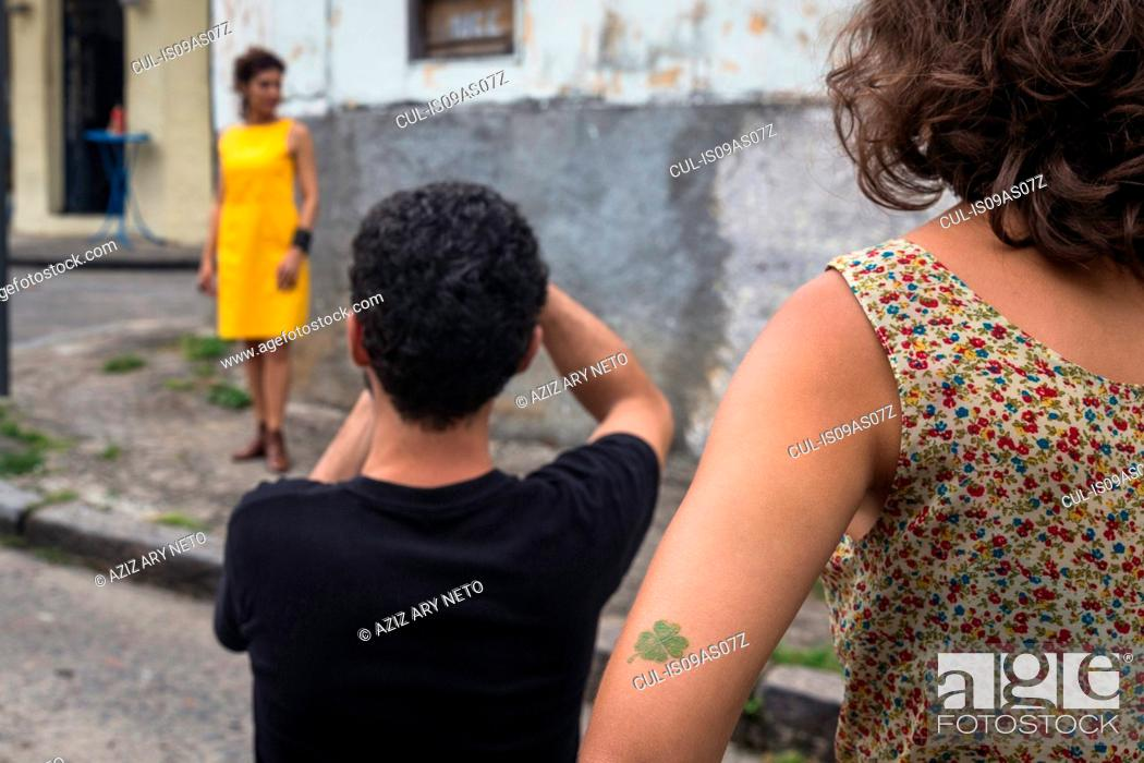 Behind the scenes of an urban fashion shoot with female