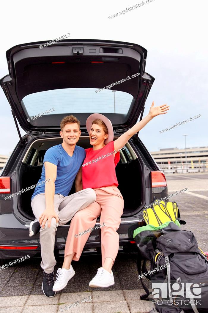 Stock Photo: Portrait of happy young couple in a car at the airport.