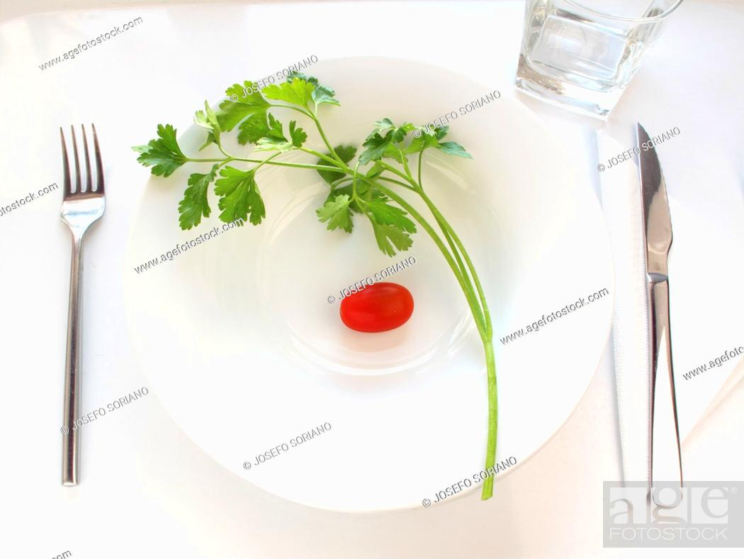 Stock Photo: Tomato and parsley.