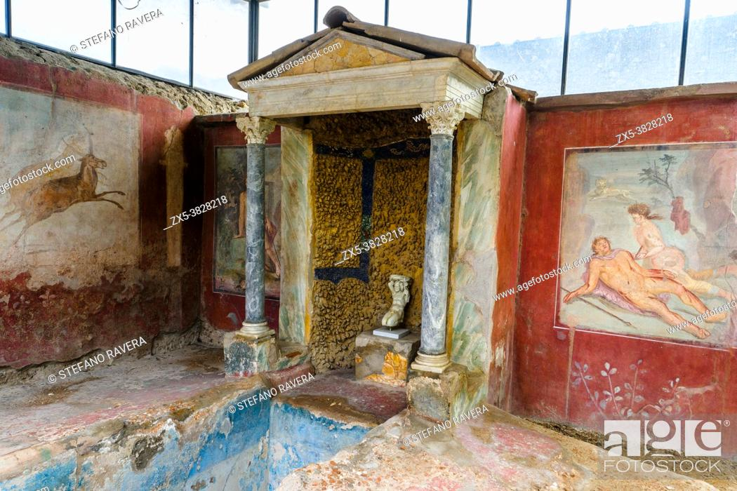 Stock Photo: Biclinium (dining room) - House of Octavius Quartio - Pompeii archaeological site, Italy Central fountain flowing from a temple style structure supported by two.