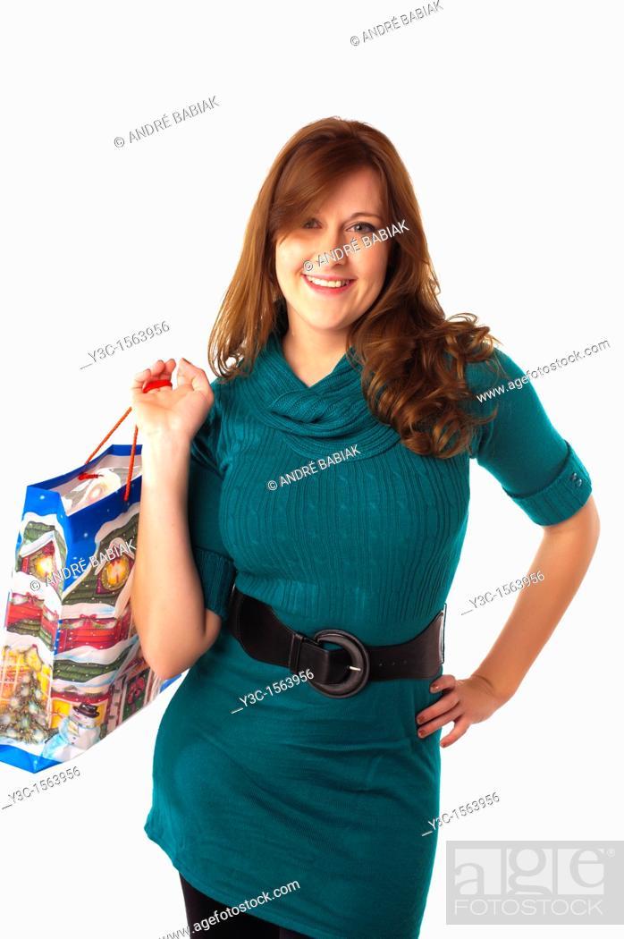 Stock Photo: Woman with Christmas theme shopping bag.