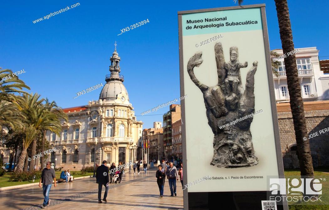Stock Photo: On background Tourist office in the Town Hall, Poster announcer of Escombreras Wreck Hand Sabazia, Mano Sabazia de S.I del pecio de Escombreras.