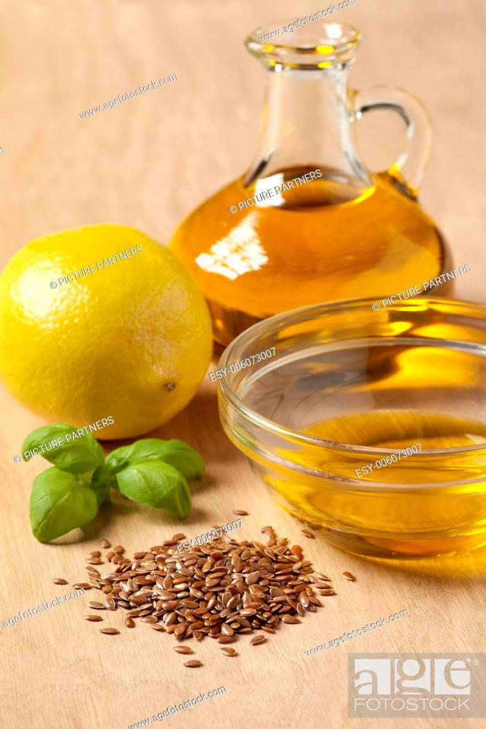 Stock Photo: Bottle of flax seed oil ready to use for a dressing.