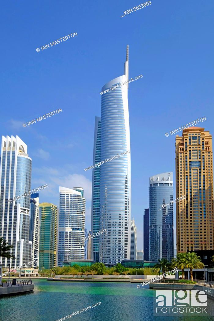 Stock Photo: Daytime skyline view of Almas Tower and modern high-rise office and apartment buildings at JLT, Jumeirah Lakes Towers in Dubai United Arab Emirates.