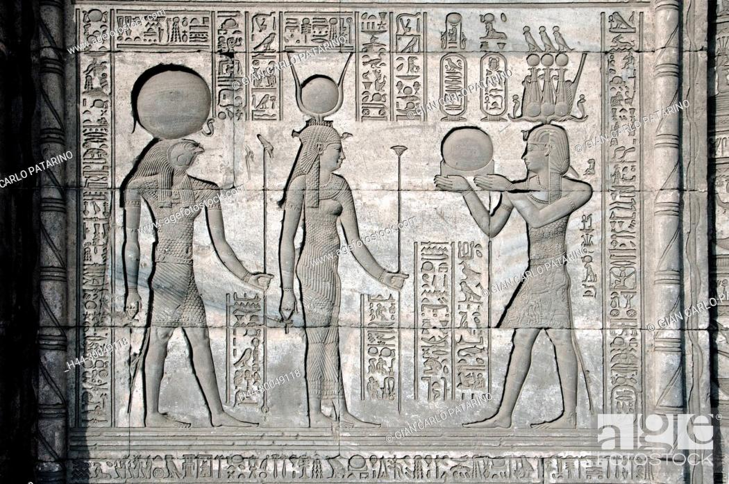 Stock Photo: Dendera Egypt, ptolemaic temple dedicated to the goddess Hathor.Carvings on external wall of the mammisi.