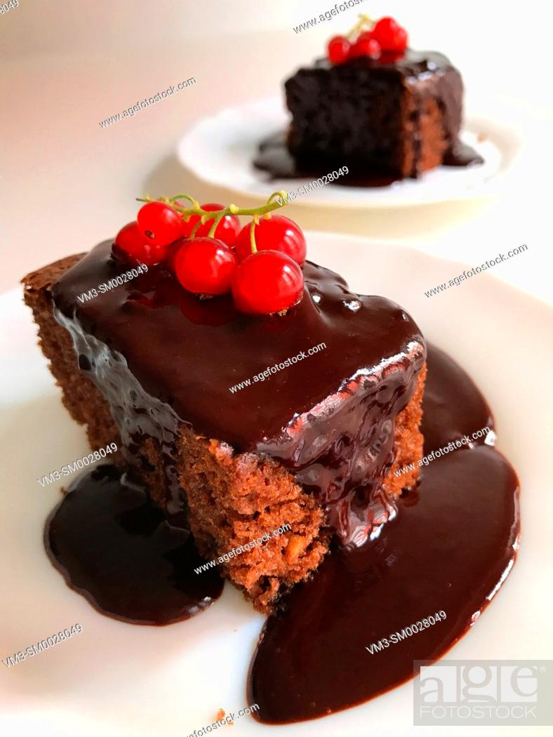 Stock Photo: Chocolate cake with chocolate sauce and redcurrants.