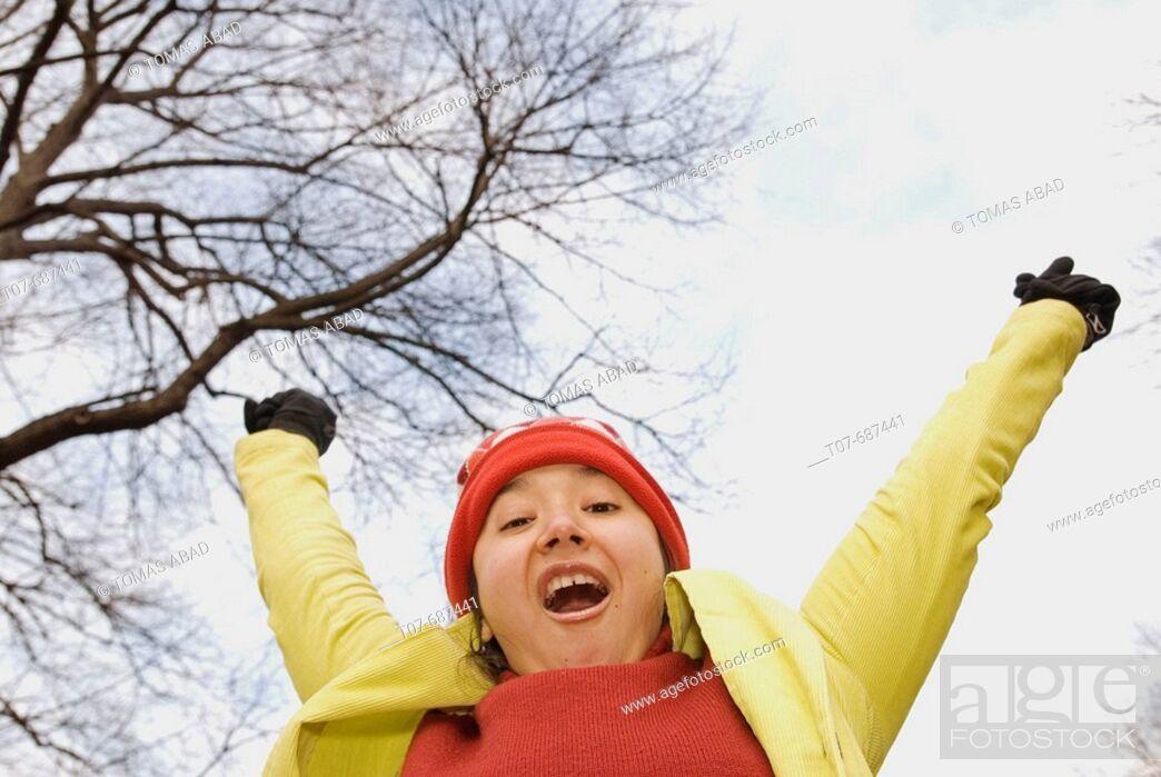 Stock Photo: Latino woman arms raised.
