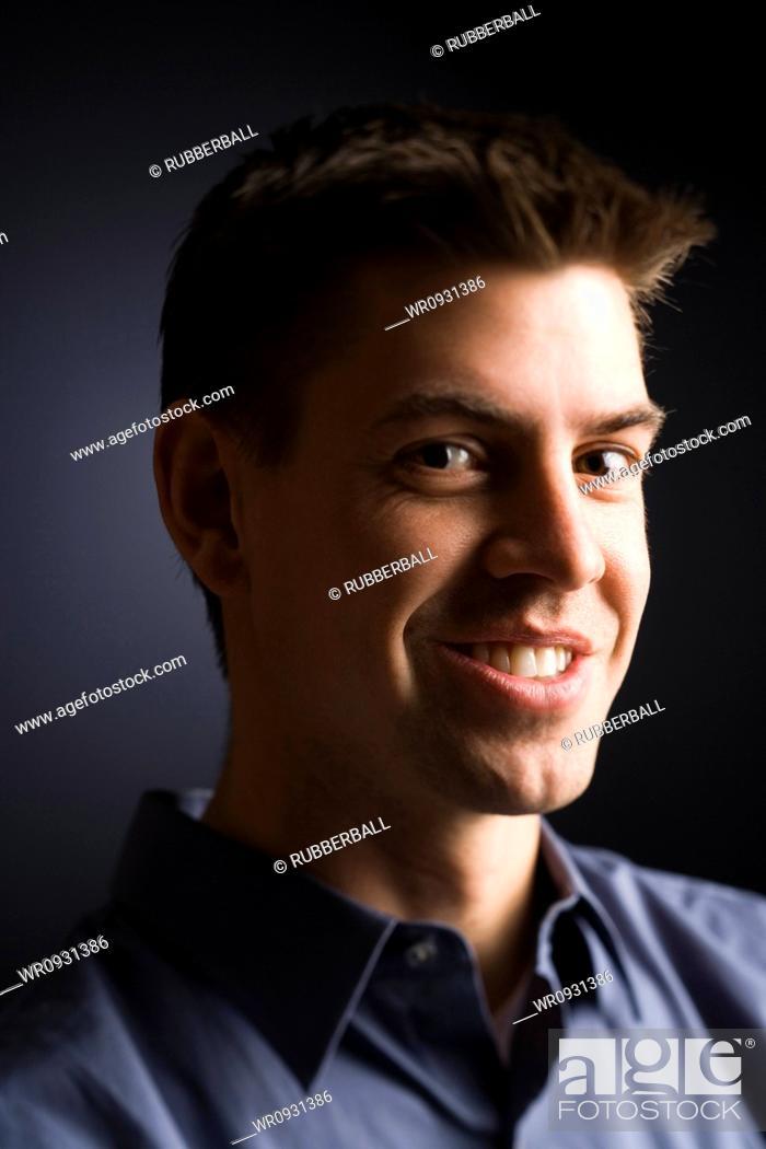 Stock Photo: Man posing in a shirt.