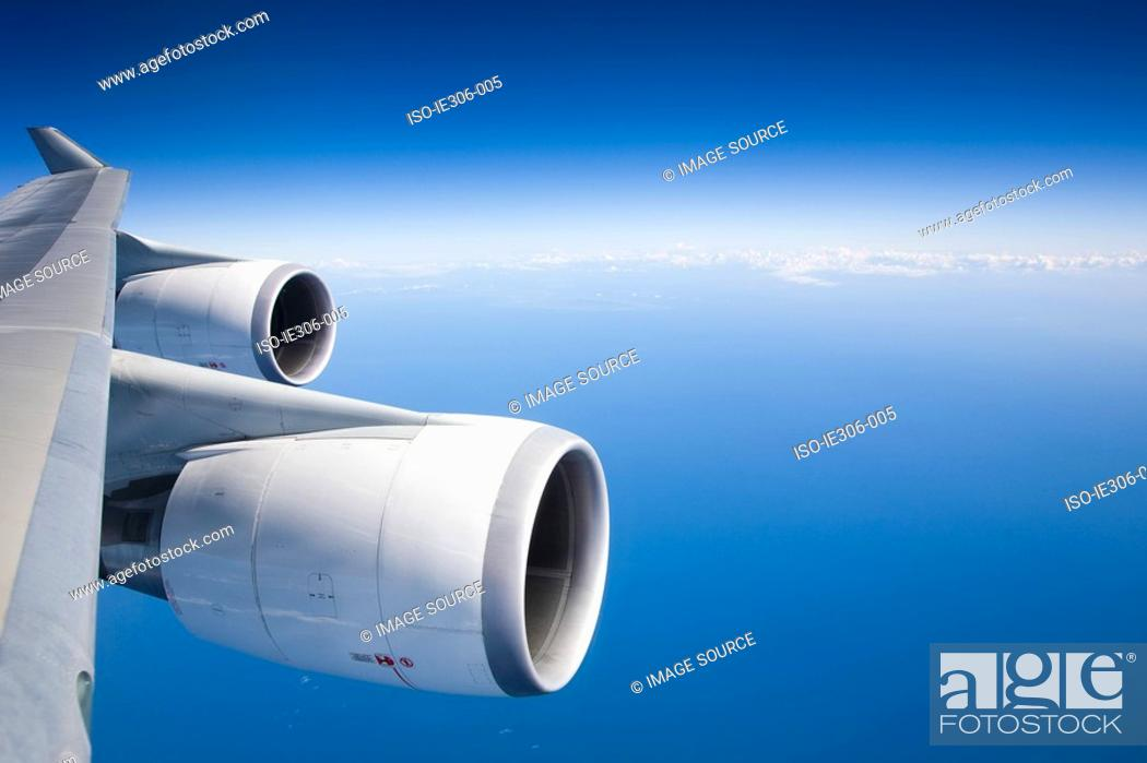 Stock Photo: Airplane engines and blue sky.