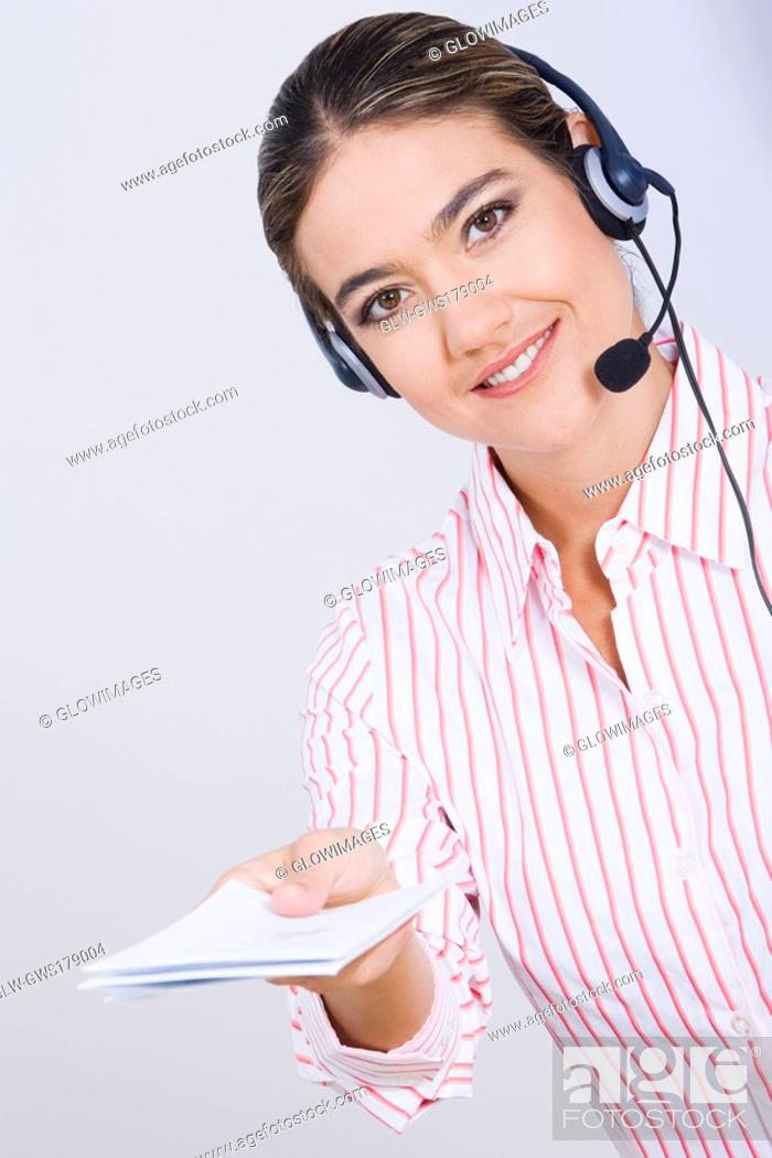 Stock Photo: Portrait of a businesswoman holding documents and smiling.
