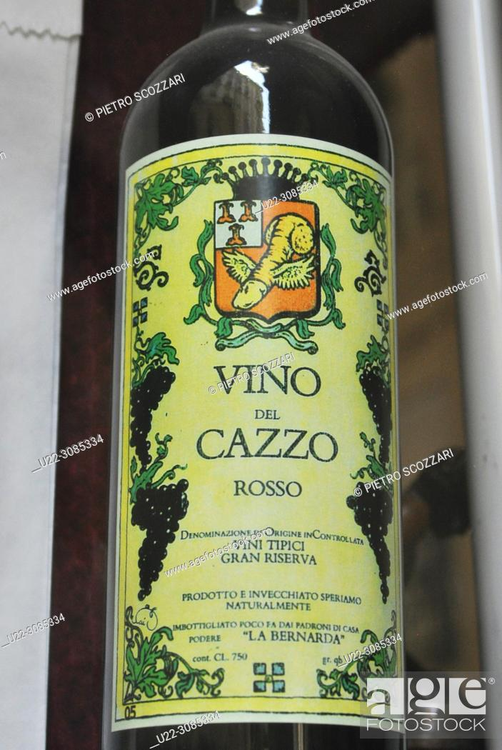 Stock Photo: Turin, Italy: 'Vino del Cazzo' ('Fucked Wine') bottle from the window of an antique shop specialized in old erotic goods.