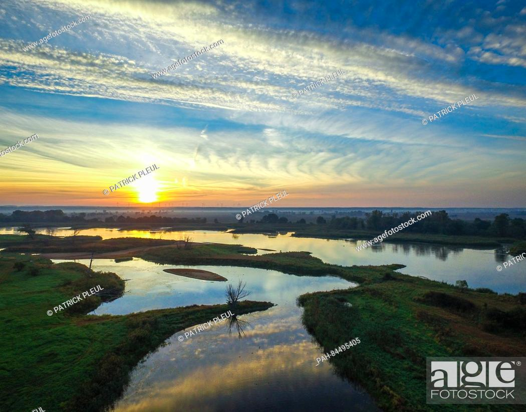 Stock Photo: An aerial photograph taken from a drone shows the river Oder (right), which runs along the German-Polish border, and backwaters, shortly after sunrise.