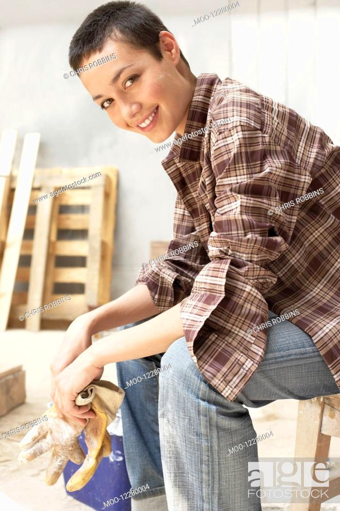 Stock Photo: Female painter on Work Break in tool room portrait side view.