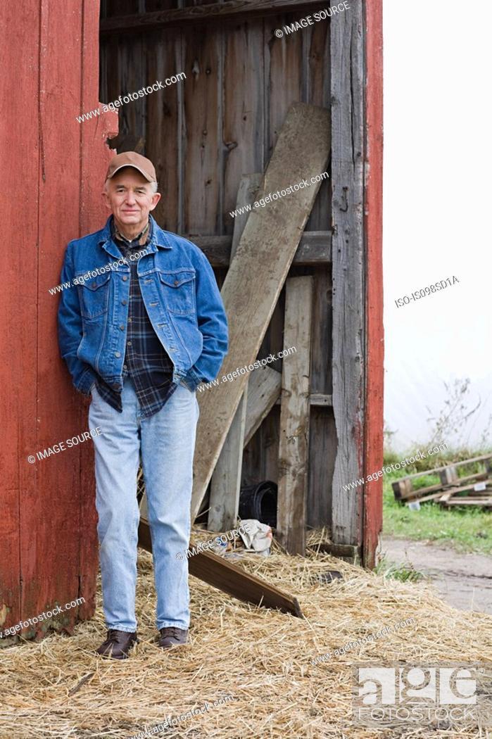 Stock Photo: Farmer outside barn.