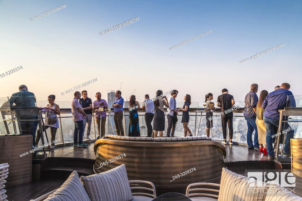 Stock Photo: Thailand, Bangkok, Riverside Area, visitors to rooftop bar at The Lebua Hotel, dusk, NR.