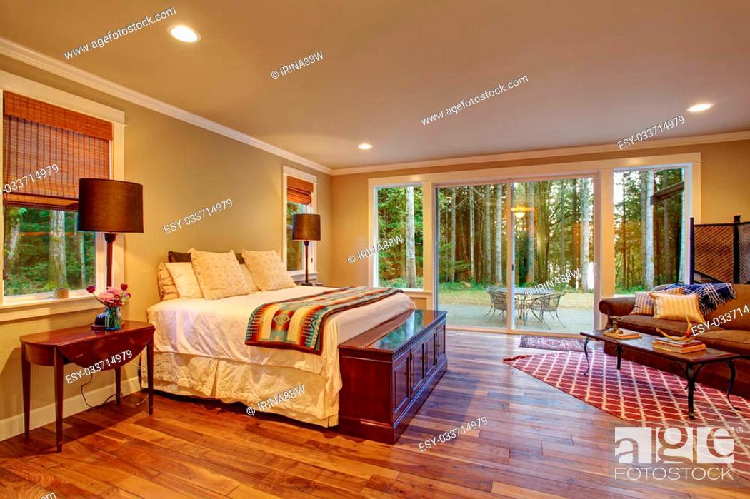 Large Master Bedroom With Hardwood Floor And Sliding Glass Door To Backyard Stock Photo Picture And Low Budget Royalty Free Image Pic Esy 033714979 Agefotostock