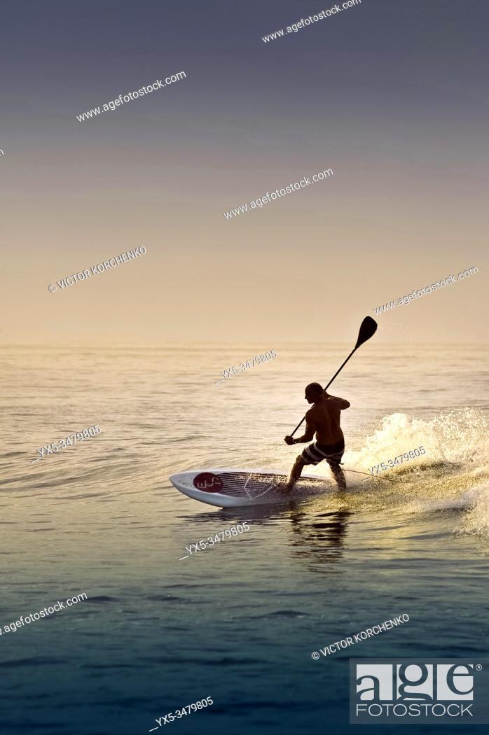 Stock Photo: Paddleboarding on a beach near Puerto Vallarta, Mexico.