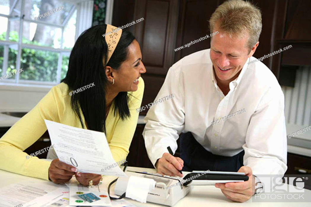 Stock Photo: High angle view of a mid adult couple smiling.