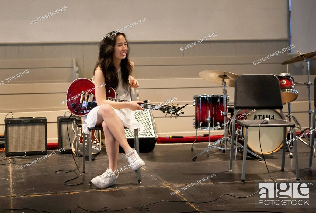 Stock Photo: Teen Girl Playing Electric Guitar on Stage.