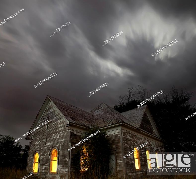 Stock Photo: Stormy night sky at an Abandoned Church near Walters, Oklahoma.